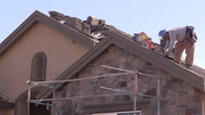 Stock Video Footage of New Home Construction, roofer nailing