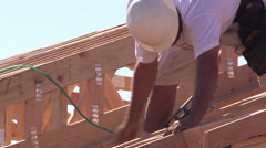 New Home Construction, carpenters nail gun Stock Footage