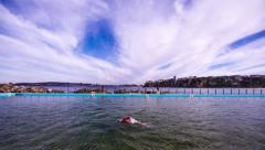 Time lapse of Swimmer in blue Ocean Pool Profile  173GYCC PAL Stock Footage