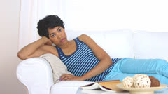 Unhappy African American woman on couch - stock footage