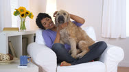 Happy African American woman with pet dog Stock Footage