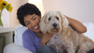 Black woman smiling and posing with pet dog Stock Footage