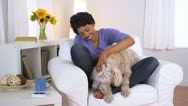 Pet dog licking owner's feet Stock Footage