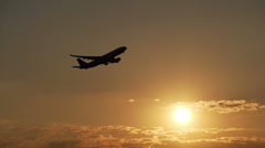 Plane taking off at sunset Stock Footage