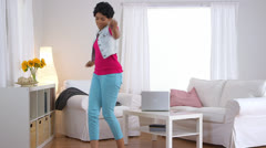 Black woman dancing then falling back into chair and kicking of shoes Stock Footage