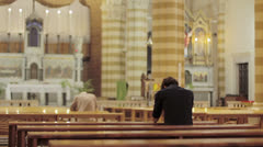 People pray in a church - stock footage