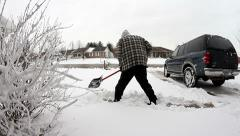 Man shoveling snow from drive way Stock Footage