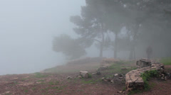 Individual man under fog on top of Gilboa Mountain Stock Footage
