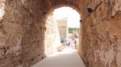 Walking in to Caesarea Maritima Stock Footage