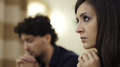 Couple  in prayer in a church Stock Footage