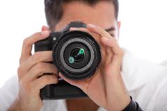 male photographer taking a photograph - stock photo