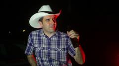 Cowboy drinking beer night Stock Footage