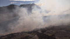 Smoke billowing up from a veld fire Stock Footage
