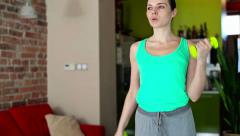 Young woman exercising with dumb-bells in homea HD Stock Footage