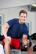 lifting weights - stock photo