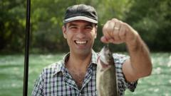 1of8 Man with rod fishing trout on river in Italy Stock Footage