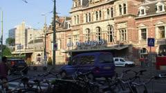 Exterior Hollands Spoor railway station (Den Haag HS) + commuters Stock Footage