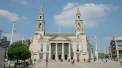 Leeds, people walking in front of civic hall, england Stock Footage