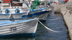 Fishing boats in Kefalos showing mooring ropes Stock Footage