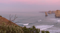Panning across the Twelve Apostles at dawn Stock Footage