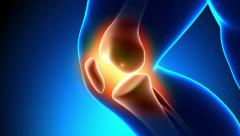 Pain in Knee - blue background - stock footage