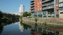 Leeds, bridgewater place and riverside apartments along river aire, england - stock footage