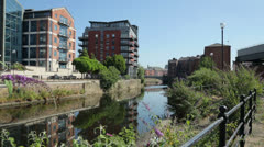 Leeds, riverside apartments along river aire Stock Footage