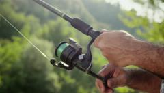 4of8 Man with rod fishing trout on river in Italy Stock Footage