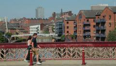 Stock Video Footage of Leeds, people walk over crown point bridge