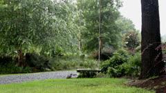 Stock Video Footage of empty swinging wooden swing in rain on tree