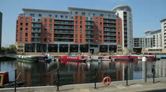 Leeds, boats and apartment buildings at clarence dock, england Stock Footage