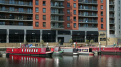Leeds, mumtaz restaurant with boats and apartment buildings at clarence dock Stock Footage