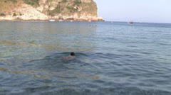 Rear view of a young woman swimming in the Ionian Sea - Sicily Stock Footage