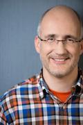 Close-up portrait of a mature balding man smiling Stock Photos