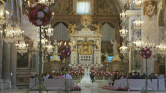 Traditional wedding in large Roman church 3 (slomo dolly) Stock Footage
