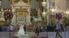 Traditional wedding in large Roman church 5 (slomo dolly) Stock Footage