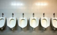 Public urinals Stock Photos