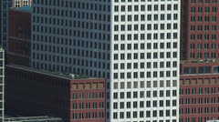 Full screen + pan high-rise office buildings + reflection in window Stock Footage