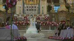 Traditional wedding in large Roman church 4 (slomo) Stock Footage