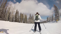 Woman skiing down a hill Stock Footage