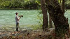 6of8 Man with rod fishing trout on river in Italy Stock Footage
