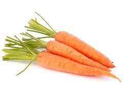 carrot vegetable with leaves - stock photo