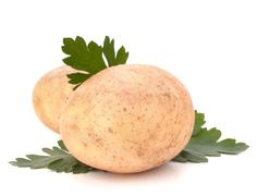 potato and parsley leaves - stock photo