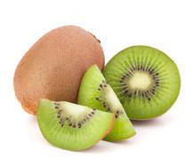 whole kiwi fruit and his segments - stock photo