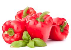 sweet red pepper and basil leaves still life - stock photo