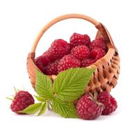 ripe raspberries in basket - stock photo