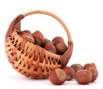 hazelnuts in wicker basket - stock photo
