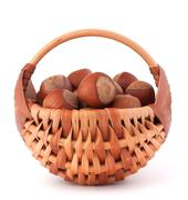 Hazelnuts in wicker basket Stock Photos