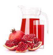 pomegranate fruit juice in glass pitcher - stock photo