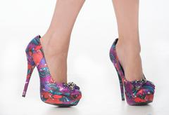 pretty purple print shoes. - stock photo
